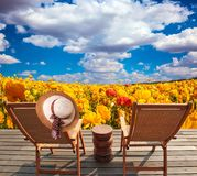 Pair of wooden comfortable sun loungers royalty free stock images