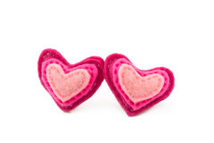 Pair of wool hearts with pink and red stripes on Royalty Free Stock Photography