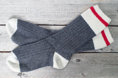 Pair of wool socks. Against wood background Royalty Free Stock Image