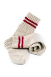 Pair of woollen hand-made socks. On a white background Stock Images