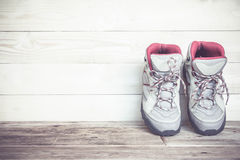 Pair of work boots on wooden background Stock Images