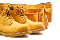 Pair of working boots and tool belt  Stock Photo