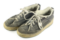 Pair of worn dirty shoes Royalty Free Stock Images