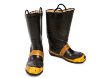 A Pair of Worn Fire Boots on White Royalty Free Stock Photography