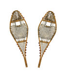 Pair of worn snowshoes. Pair of weathered snowshoes on a white background royalty free stock photo