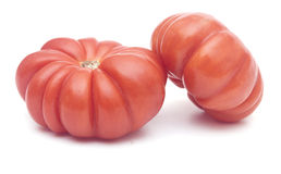 A pair of wrinkled zapotec heirloom tomatoes Royalty Free Stock Images