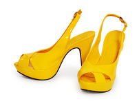 Pair of yellow female shoes isolated on white Stock Photos