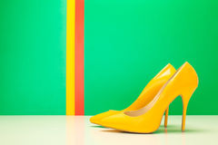 Pair of yellow high heels Stock Images