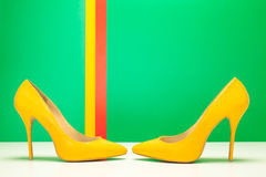 Pair of yellow high heels Royalty Free Stock Images