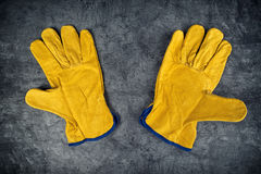 Pair of Yellow Leather Construction Work Gloves Stock Photo