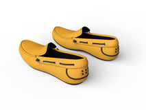 Pair of yellow loafers with black stitching - top back view Royalty Free Stock Images