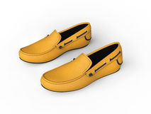 Pair of yellow loafers with black stitching - top view Royalty Free Stock Photo