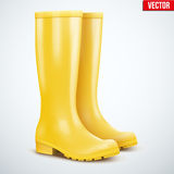 Pair of yellow rain boots Royalty Free Stock Photography