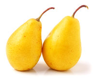 Pair of yellow ripe, juicy pears. On a white background. Royalty Free Stock Photography