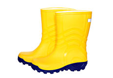 Pair of yellow rubber boots Royalty Free Stock Images