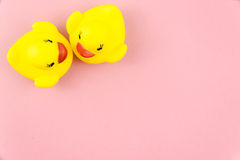 Pair of yellow rubber ducks  over colorful background Royalty Free Stock Image