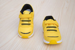 Pair of yellow sporty shoes for kid Stock Images