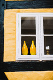 Pair of yellow vases in window Stock Image