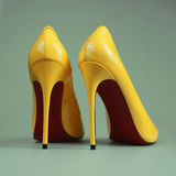 Pair of yellow women`s heel shoes royalty free stock image