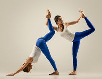 Pair yoga. couple women. Duo Pose Stock Photography