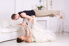 Pair Yogi. Man and women yoga in a bright room Royalty Free Stock Photography