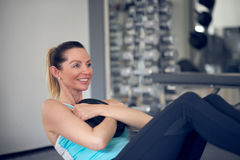 Pair of young adult women doing abdominal muscle training royalty free stock image