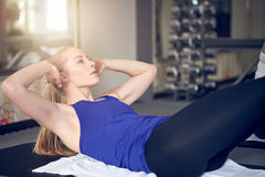 Pair of young adult women doing abdominal muscle training stock photography