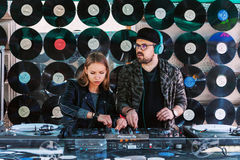 Pair of young DJ mixing music. Vilnius, Lithuania - May 21, 2016: Pair of young DJ mixing music on the street in Vilnius, Lithuania Royalty Free Stock Photos