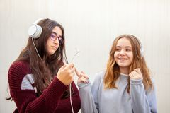 A couple of teenage girls have fun with their headphones stock photos