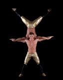 Pair of young muscular half-naked acrobats Royalty Free Stock Photography