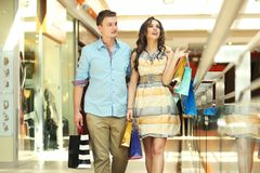 Pair of young people. In a shopping center Stock Image