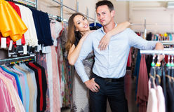 Pair of young positive people in women clothes boutique Stock Photo