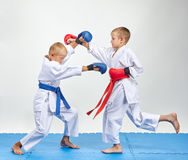 Paired exercise of karate are training athletes with overlays on his hands. Paired exercise are training athletes with overlays on his hands Royalty Free Stock Photo