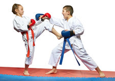Paired exercises karate in performing athletes in karategi Stock Photo