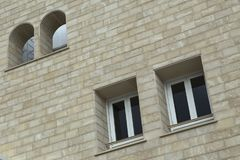 Paired windows in a brick building. Limassol. Cyprus Royalty Free Stock Photo