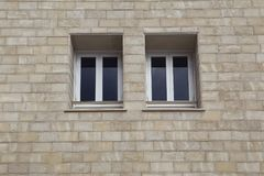 Paired windows in a brick building. Limassol. Cyprus Royalty Free Stock Photography