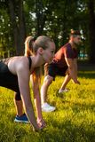 Paired workout outdoor fitness sport exercises. Concept. work of trainer. lifestyle of sportsman Royalty Free Stock Photos