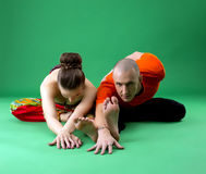 Paired yoga training. Instructor looking at camera Royalty Free Stock Photography