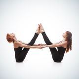 Paired yoga on a blue background