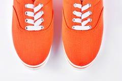 Paires d'haut étroit d'espadrilles oranges Images stock