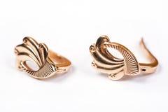 Paires de boucles d'oreille d'or Images libres de droits