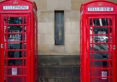 Paires de cabines téléphoniques rouges, R-U Photographie stock