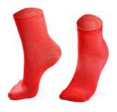 Paires de chaussettes rouges d'isolement sur le fond blanc photo libre de droits