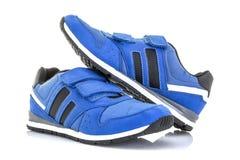 Paires de chaussures bleues de formation Photos stock