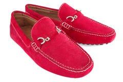 Paires de chaussures d'hommes rouges au-dessus de blanc Photos stock