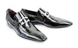 Paires de chaussures noires de man?s Photographie stock
