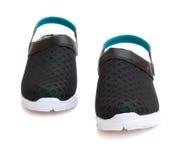 Paires de chaussures noires sur un fond blanc avec le chemin de coupure Photographie stock