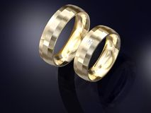 Paires de conception de boucles de mariage d'or Photographie stock libre de droits