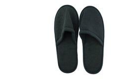 Paires de fond d'intérieur noir d'isolat de pantoufles photographie stock libre de droits
