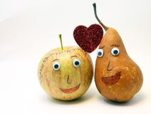 Paires de fruits : Apple et POIRE avec de grands yeux Image stock